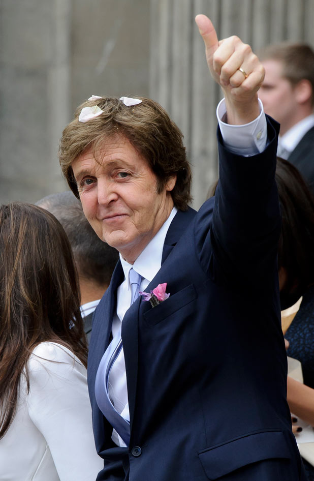 Sir Paul gives his trademark thumbs-up
