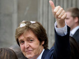 Sir Paul gives his trademark thumbs-up to fans after the 45-minute ceremony.