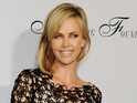 Charlize Theron says her role as the Evil Queen has made her feel like a child.
