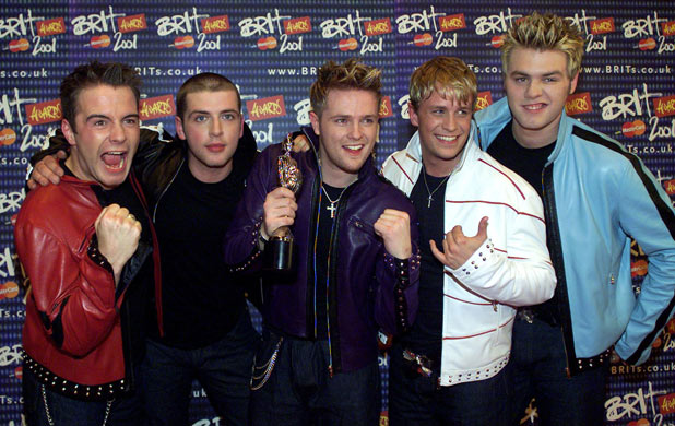 Westlife  pose for photographers with their award for the Best Pop Act during The Brit Awards 2001