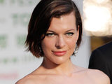 "Milla Jovovich arrives at the green carpet for the premiere of ""The Three Musketeers"" at the Tokyo International Film Festival."