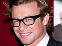 Simon Baker jokes that his family would oppose him becoming an American citizen.