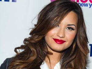 Demi Lovato attends Z100's Jingle Ball '11 kick off party at the Aeropostale Times Square store, in New York.