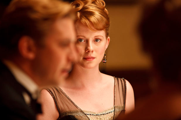 ZOE BOYLE as Lavinia Swire.