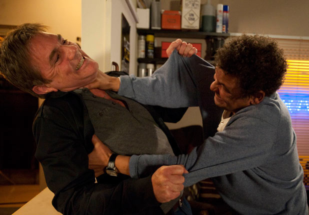 Lloyd pins Karl up against the wall after he insults Cheryl