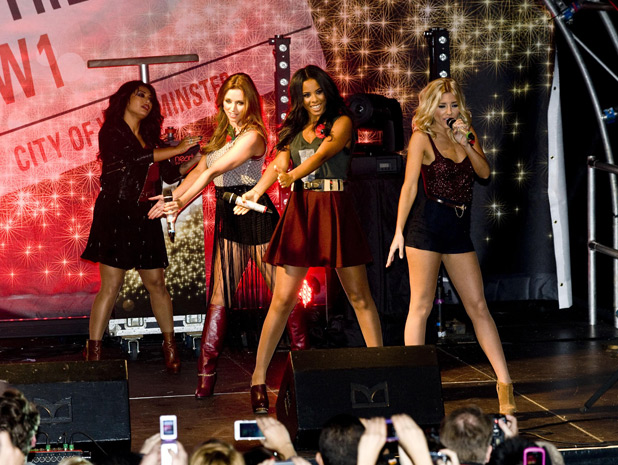 The Saturdays perform before the Oxford Street Christmas lights are switched on, London