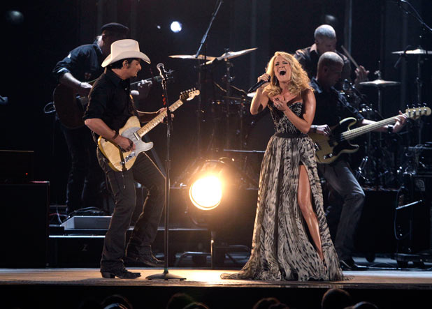 Hosts Brad Paisley and Carrie Underwood duet on 'Remind Me'.
