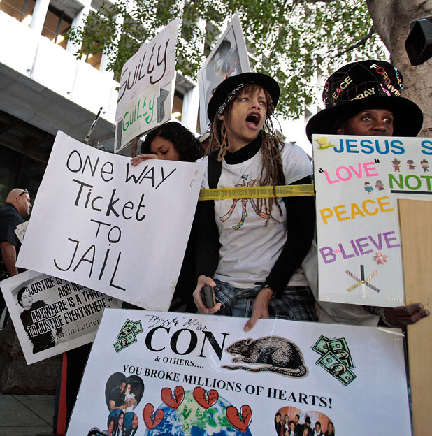 Demonstrators stand outside the Criminal Justice Center in downtown Los Angeles