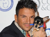 Peter Andre cuddles a canine pal at the Battersea Dogs & Cats Home Collars and Coats Ball