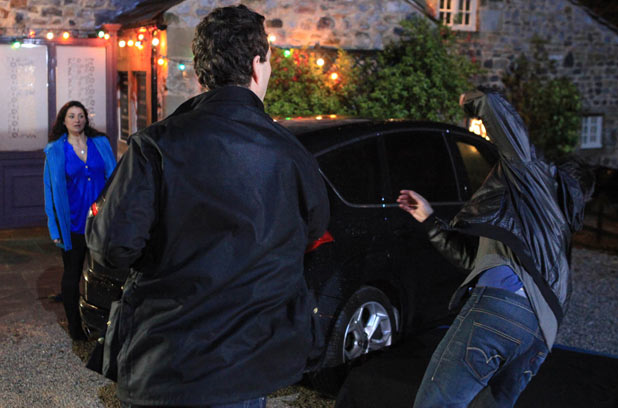 John Barton (James Thornton) punches Cain Dingle (Jeff Hordley)