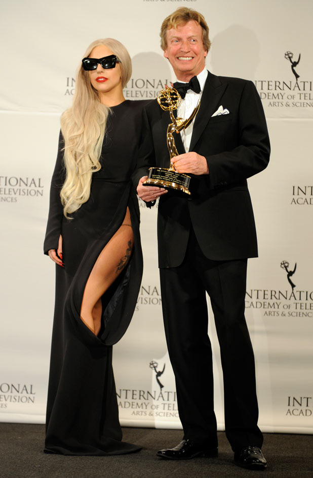 Lady Gaga, left, and producer Nigel Lythgoe pose after she presented him with the Founders Award at the 39th International Emmys