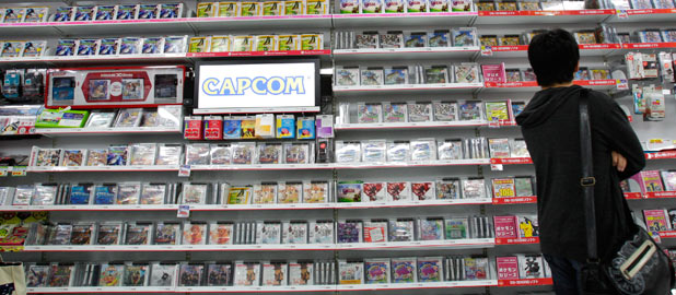 A shopper browses through video game in a store