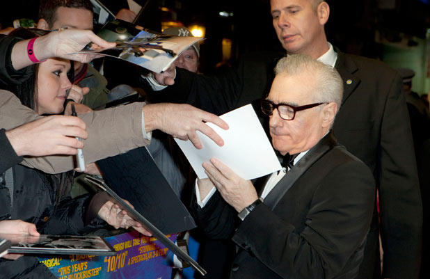 Director Martin Scorsese signs autographs