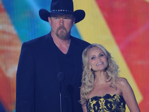 Trace Adkins and Kristin Chenoweth at the American Country Awards 2011 on Fox