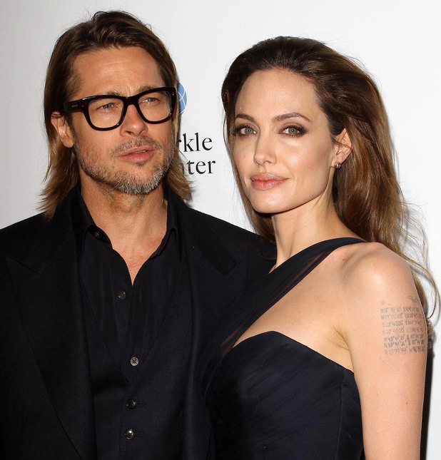 Angelina Jolie and Brad Pitt The premiere of 'In the Land of Blood and Honey' Hollywood, California