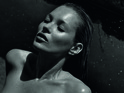 The supermodel strips off in the moody black-and-white shot.