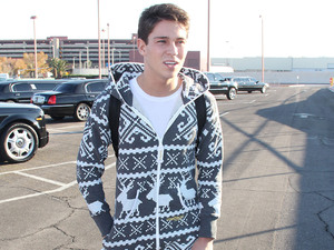 Joey Essex arriving at Las Vegas Maccaran International Airport wearing a christmas style Onesie jumpsuit. Las Vegas, Nevada