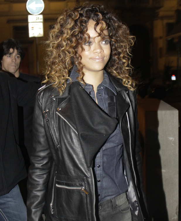 Rihanna leaves the Armani store in Milan after attending a party. The singer has recently teamed up with Emporio Armani Underwear and Armani Jeans to create her first fashion line. Milan, Italy