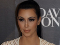 Kim Karadshian denies going to Haiti to attend a fashion show.