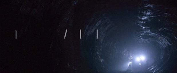 A dark, claustrophobic cave