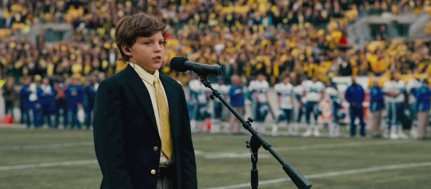 A young boys sings 'Star-Spangled Banner'