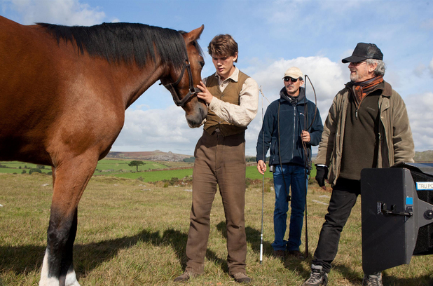 Jeremy Irvine and Steven Spielberg in-between takes.