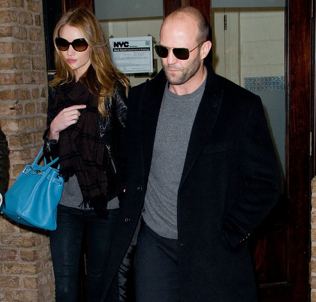 Jason Statham and Rosie Huntington-Whiteley leave a hotel on a cold winter day. Newe York City