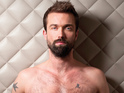 Click in to see Hollyoaks star Emmett Scanlan shirtless in Gay Times.