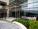 US tech giant reports a 22% drop in profits, but bets big on Windows 8 launch.