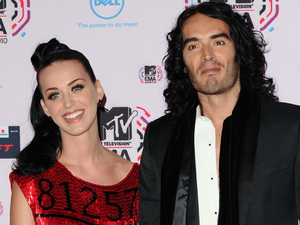 Katy and Russell appear for the first time as husband and wife