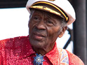 Rock legend Chuck Berry has to be helped off stage after collapsing during a gig in Chicago.