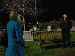 Hazel places flowers on Jackson's grave before leaving, watched by Aaron