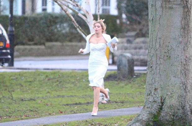 Charity Tate (Emma Atkins) rushes to make her wedding on time