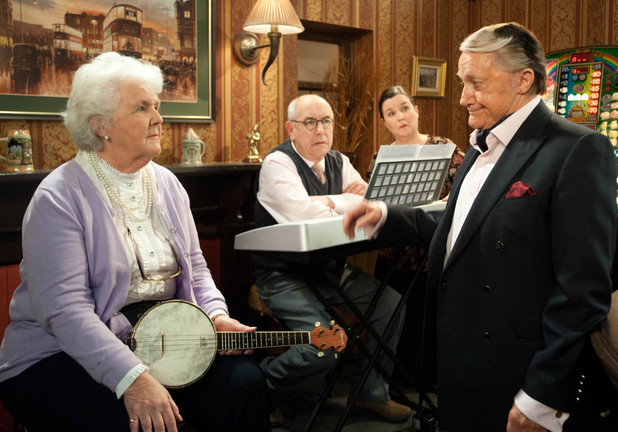 Milton (Robert Vaughn) surprises Sylvia Goodwin (Stephanie Cole) at The Rovers