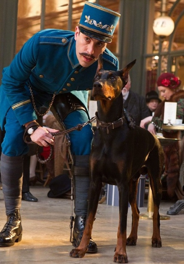 Sacha Baron Cohen and Maximilian the Doberman pinscher in 'Hugo'