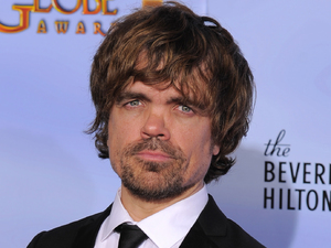 Actor Peter Dinklage poses backstage with the award for Best Supporting Actor in a Series, Mini Series or TV Movie for &quot;Game of Thrones&quot;