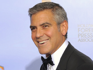 George Clooney with his award for 'Best Actor in a Motion Picture (Drama)'