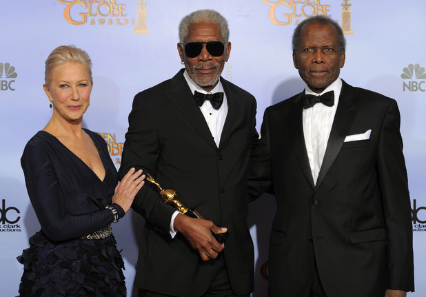 Morgan Freeman, center, poses backstage with the Cecil B. Demille Award with Helen Mirren, left, and Sidney Poitier, right, during the 69th Annual Golden Globe Awards