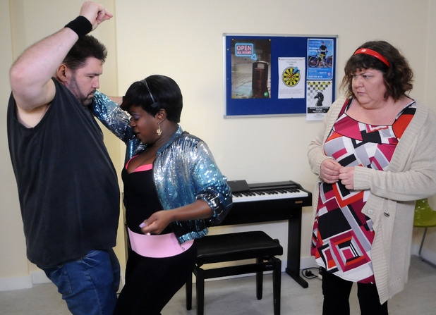Andrew Cotton (Ricky Grover) shows off his dance moves