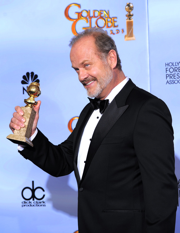 Kelsey Grammer shows off his award for Boss