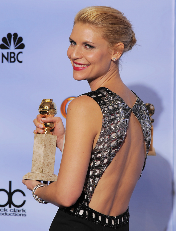 "Claire Danes poses backstage with the award for Best Actress in a Dramatic TV Series for ""Homeland"""