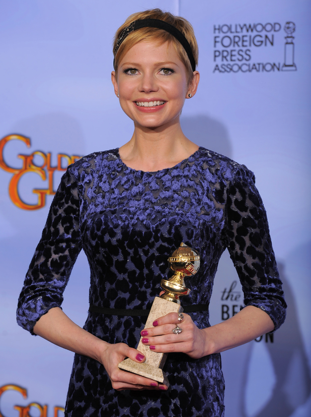 Michelle Williams with her award for 'Best Actress in a Motion Picture (Musical or Comedy)'