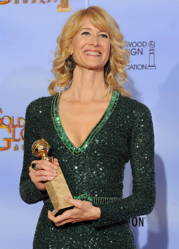Laura Dern poses with her award for her role in Enlightened