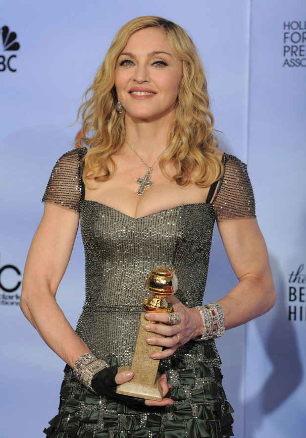 "Madonna poses backstage with the award for Best Original Song in a Motion Picture for the song ""Masterpiece"" from the film ""W.E."""
