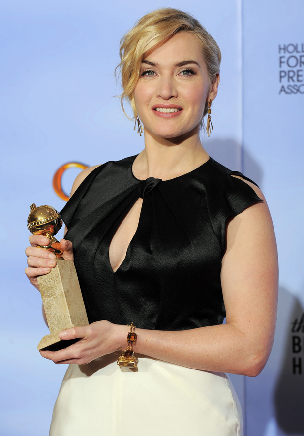 "Kate Winslet poses backstage with the award for Best Actress in a Mini Series or TV Movie for ""Mildred Pierce"""