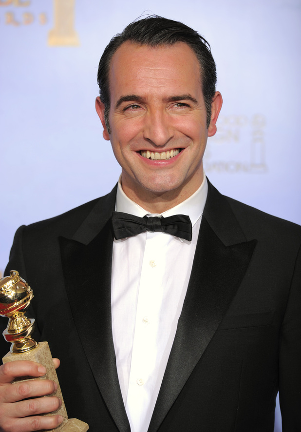 Actor Jean Dujardin poses backstage with the award for Best Motion Picture - Comedy or Musical for the film &quot;The Artist&quot;