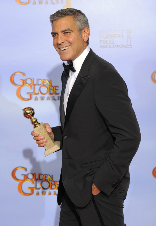 George Clooney with his award for &#39;Best Actor in a Motion Picture (Drama)&#39;