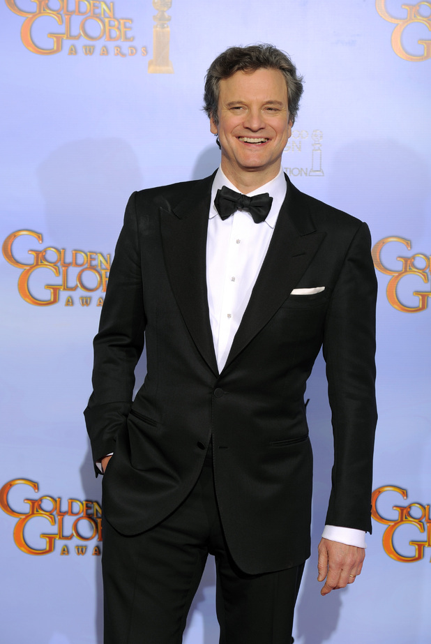 Actor Colin Firth poses backstage during the 69th Annual Golden Globe Awards