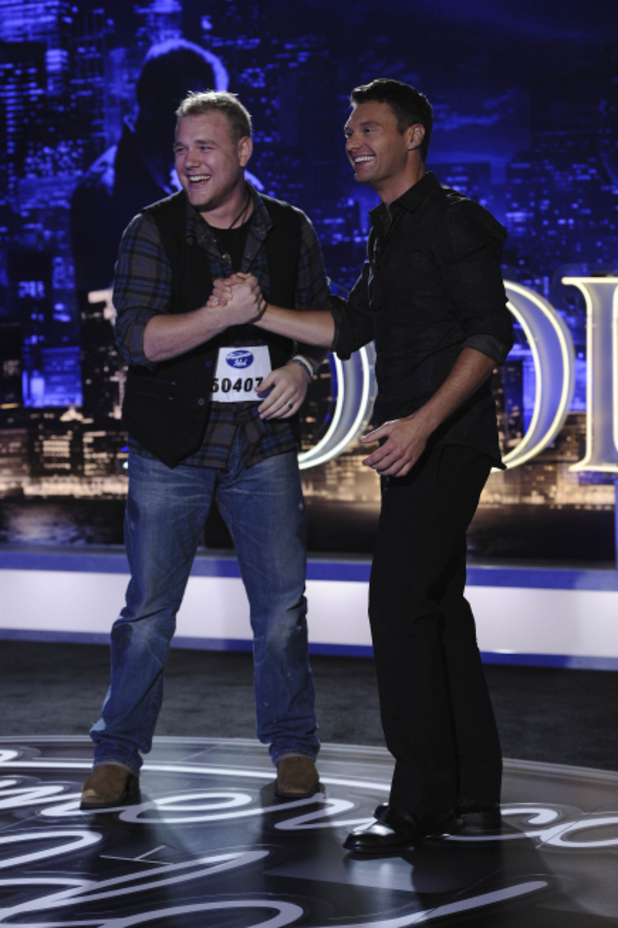 Ryan Seacrest with contestant William Thompson