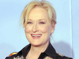 Actress Meryl Streep poses backstage with the award for Best Actress in a Motion Picture Drama